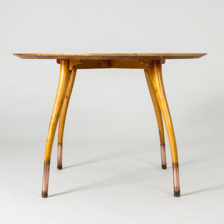 Beautiful Swedish modern occasional or playing table, made with a stunning root tabletop. Elegantly curved beech legs, copper-clad at the base.