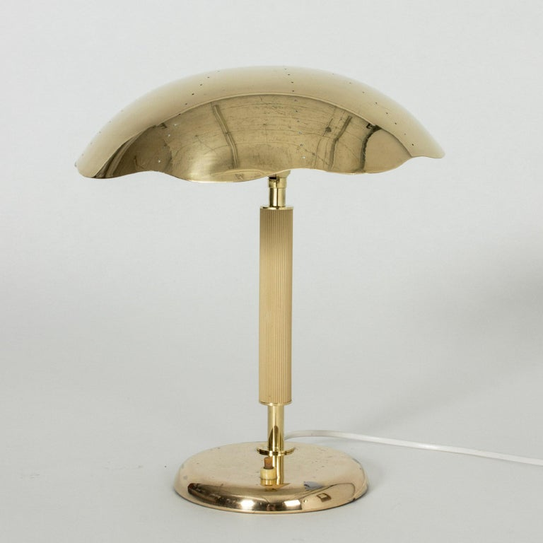 Neat Swedish Modern brass table lamp from Böhlmarks, with a wavy edged shade, perforated with small holes.