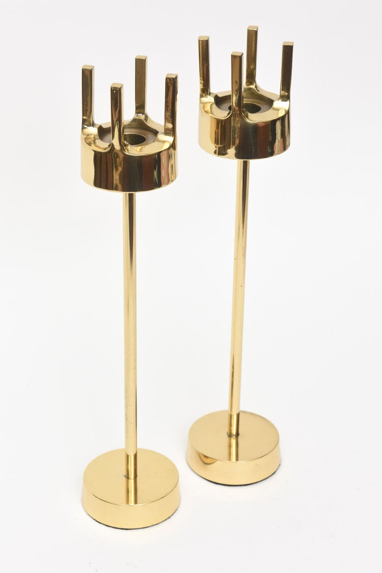 This great pair of vintage Swedish polished brass modernist midcentury brass candlesticks are in the style and attribution of Pierre Forsell for Skultana. Their period is late 1950s-early 1960s. They are not signed. They are sculptural, artful and