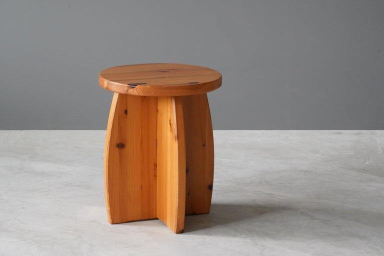 A Swedish pinewood stool or side table. By unknown designer, 1970s. Purity of form enhances the beauty of wood. 