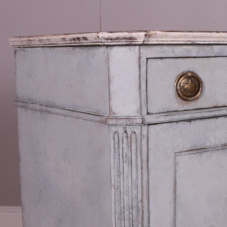 Pretty two door painted Swedish buffet. 1820.  Dimensions 36.5 inches (93 cms) wide 17 inches (43 cms) deep 34 inches (86 cms) high.
