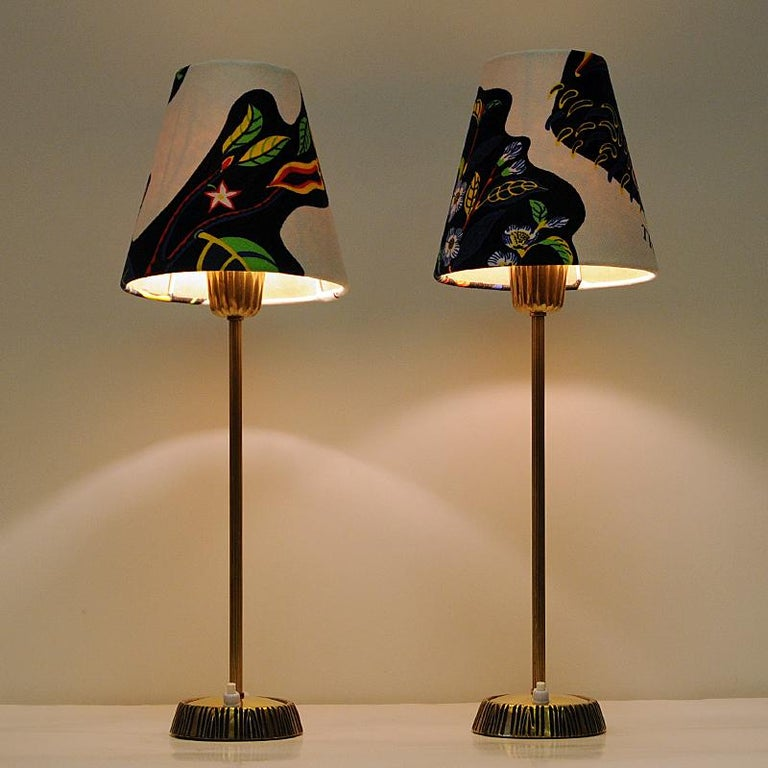 Pair of table lamps in brass designed by Sonja Katzin and produced by ASEA in the 1950s, Sweden. Beautiful patina and gorgeous design with carved stripe patterns on the brass base. Lightbutton placed on the base. Lampshades with Josef Frank fabric.