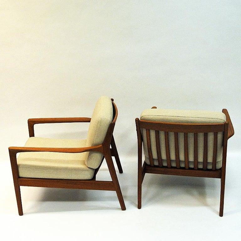 Scandinavian Modern Swedish Pair of Teak Loungechairs Mod USA 75 by Folke Ohlsson for DUX, 1960s For Sale