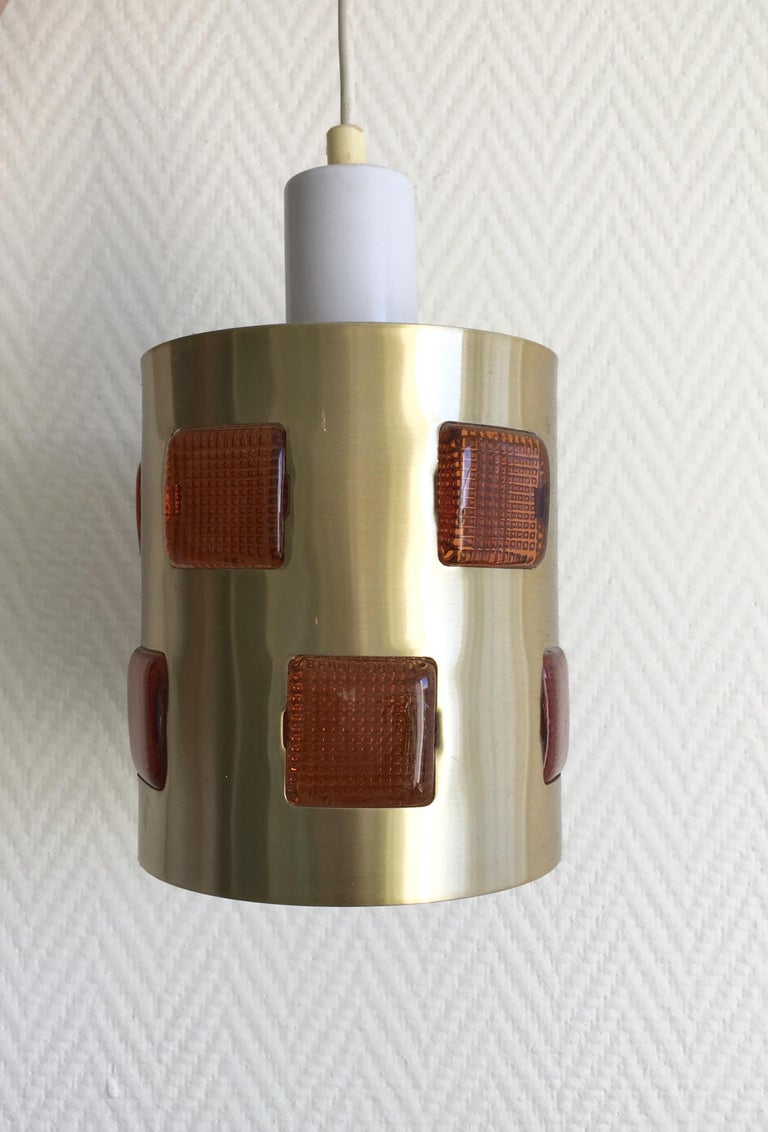 Small metal and glass lamp which was designed and manufactured in Sweden, 1960s. The lamp remains in good condition and features a sticker 'Made in Sweden'. Normal signs of age and use (some small scratches and minor dents). Rare