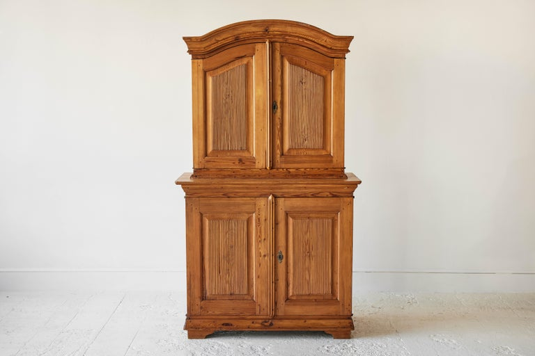 Swedish pine four door hutch with arched top. Interior is painted a rustic green.