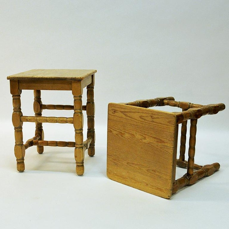 Great and solid pine stools from circa 1920s, Sweden. Nice pair of stools in barock style. Perfect as an extra little chair or as side tables. Lovely details and patina all over the stools. Good vintage condition. Measures: 45 cm H x 34 cm W x 36