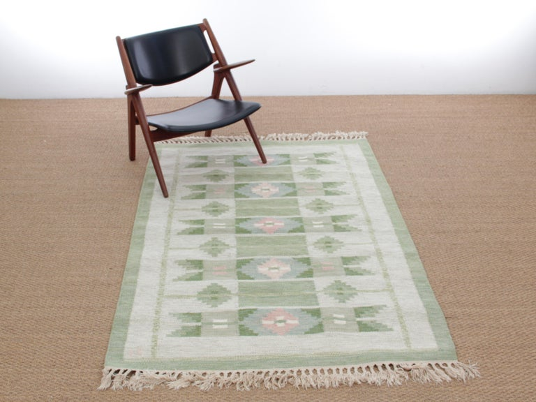 Swedish Rolakan carpet handwoven wool. Geometric patterns. Signed with monograms IS. 200 x 140 cm.  Measures: Width 166 cm, diameter 92 cm, thick 0.8 cm.
