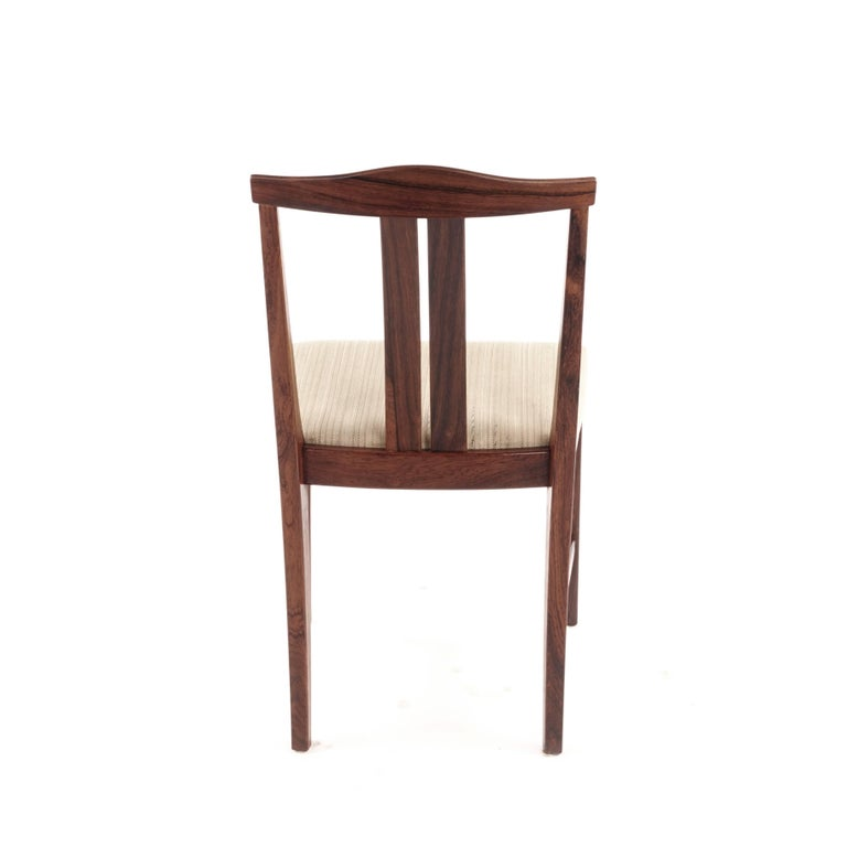 Four chairs, Sweden, 1960s-1970s, frame of rosewood, seats upholstered in bright cloth, attributed Bertil Fridhagen for Swedish furniture factory Bodafors.   There were many furniture manufacturers in Sweden in the past. One of the largest was