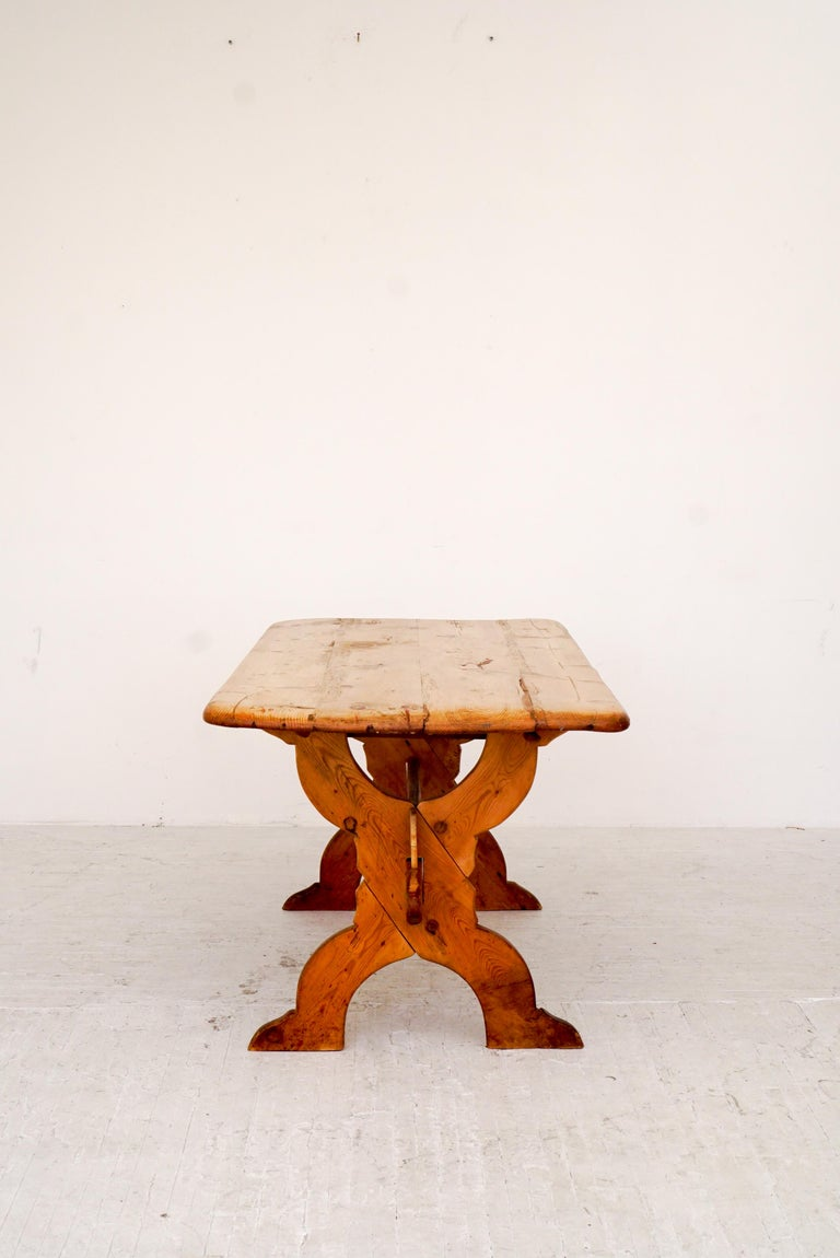 A 19th century antique pine table. Heavy patina from years of use and worn to perfection. Wood joinery and solid construction. Worm wood holes and knots.
