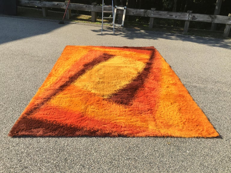 Vintage 1960s wool Rya rug in vibrant yellow, orange and brown abstract design. Expertly woven. Very clean. Ready to place. Actual dimensions: 11'9