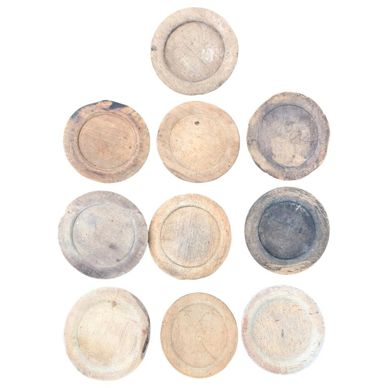 Collection of 10 rustic Folk Art dinner plates of wood, circa 1780s-1830s  Could be used for trays, serveware or under-plates.  Pricing is per item. Diameter of the plates range from 17cm to 19cm (between 6.7 inches and 7.5 inches), most of the