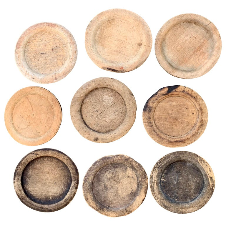 Collection of 9 rustic Folk Art dinner plates of wood, circa 1780s-1880s  Could be used for trays, serve-ware or under-plates.  Pricing is per item. Measures: Diameter of the plates range from 17cm to 19cm (between 6.7 inches and 7.5 inches),
