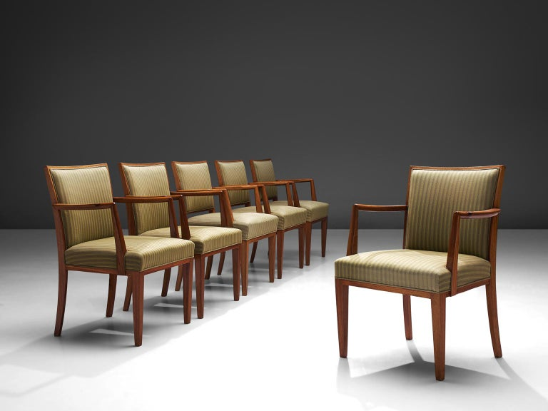 Set of six armchairs, in teak and fabric, Sweden, 1940s.   Set of six elegant conference chairs in the style of Hansen Lysberg. These well made armchairs have a beautiful teak wooden frame. The slightly curved armrest is nicely detailed, and shows a