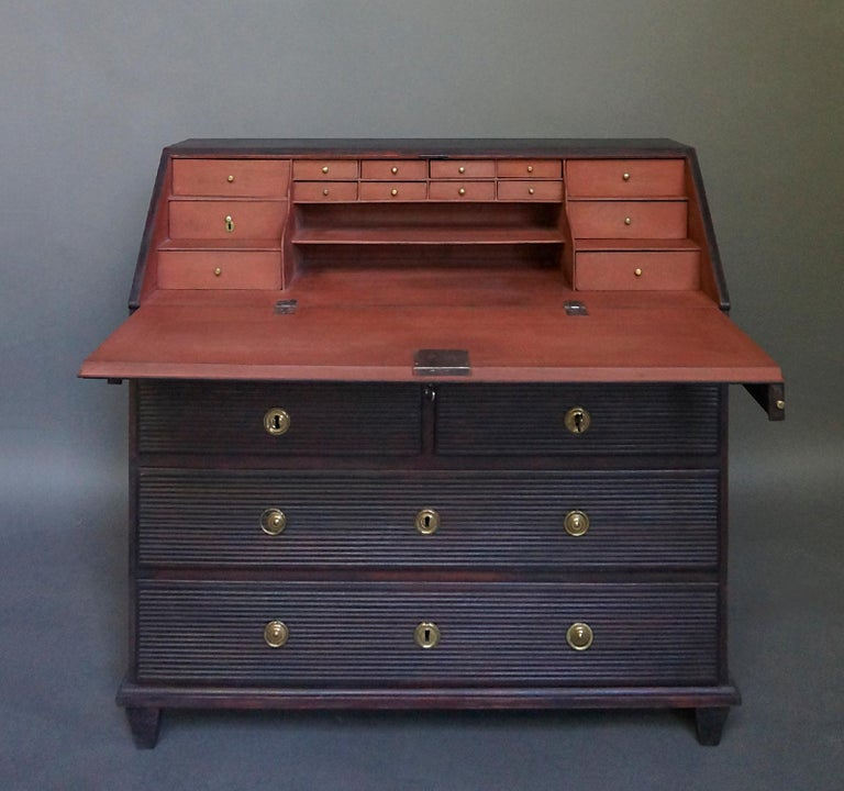 19th century Swedish writing desk, circa 1860. The fitted interior has multiple small drawers, one of them fitted with a tiny brass lock. Below the slant front is a shallow drawer over a pair of half-width drawers over two full -width drawers.