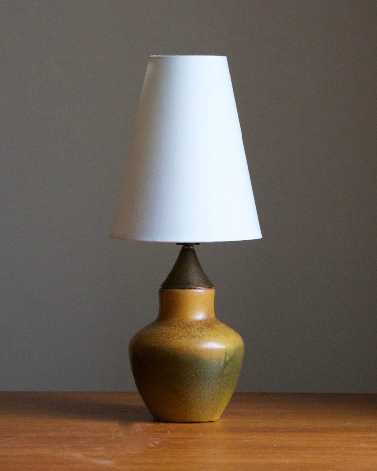 A small table lamp. Designed and produced in Sweden, 1940s. Brand new lampshade.