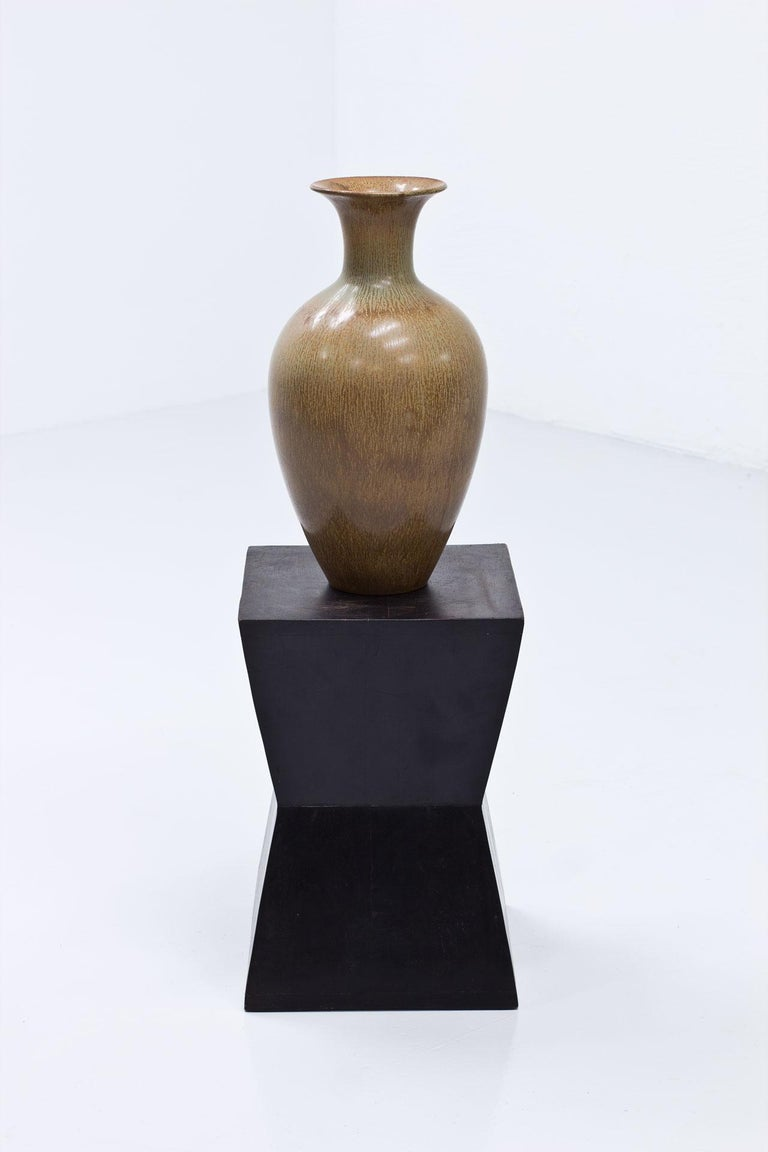 Stoneware floor vase designed by Gunnar Nylund. Manufactured by Rörstrand, Sweden during the 1950s. Hare fur glaze in light brown and green.