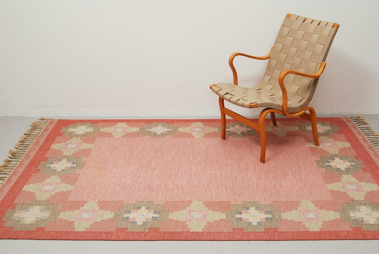A flat-weave Rölakan carpet named
