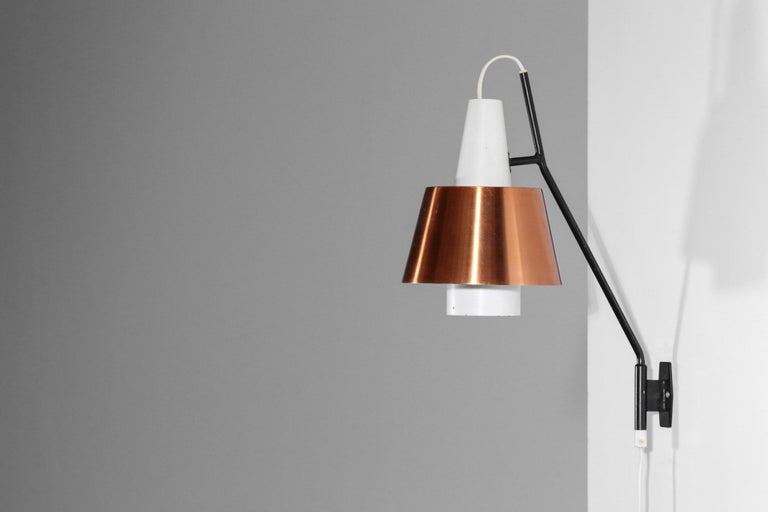 Swedish wall light from 1960s edited by Luco. Structure in steel with copper shade.