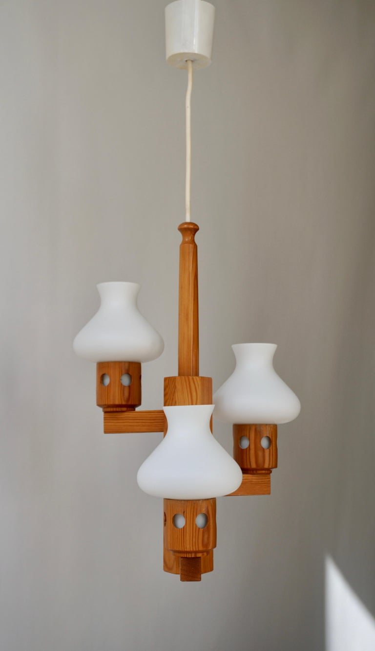 Chandelier, pine wood and opaline white glass, Sweden, 1950s -1960s - 1970s. 