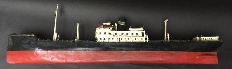 A vintage 1940 Swedish handmade model of a steamship. Made in wood with paper and metal details. Original paint.