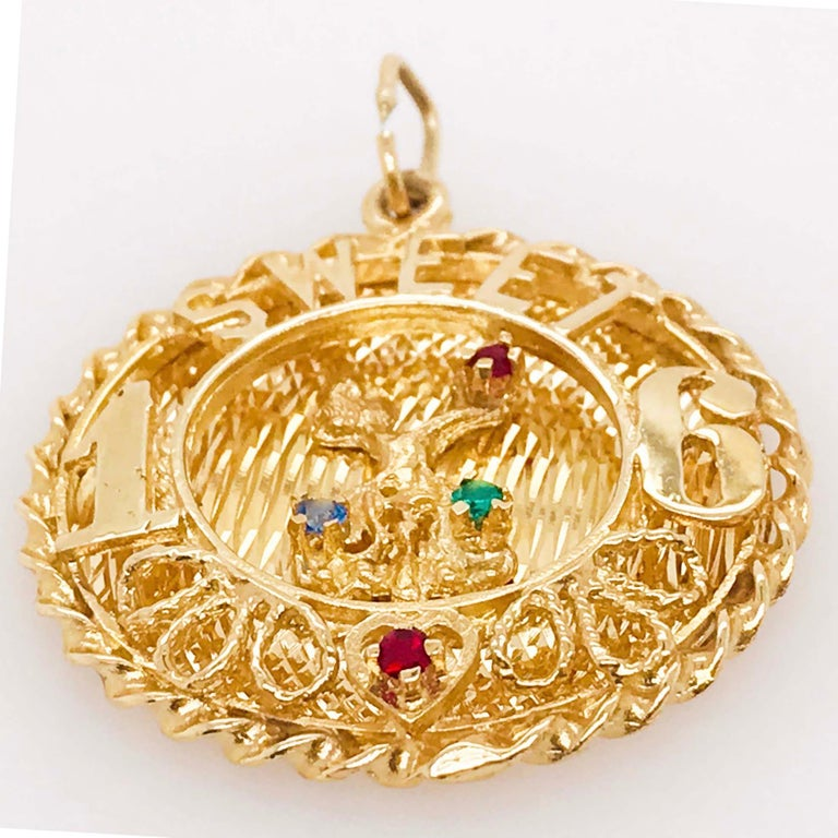 The 14 kt gold Sweet 16 large charm is a handmade fine jewelry item. The disk charm is made with 14k yellow gold that is rich in color! The charm has a round shape with a twisted gold rope framing the disk. On the top there are handmade letters that