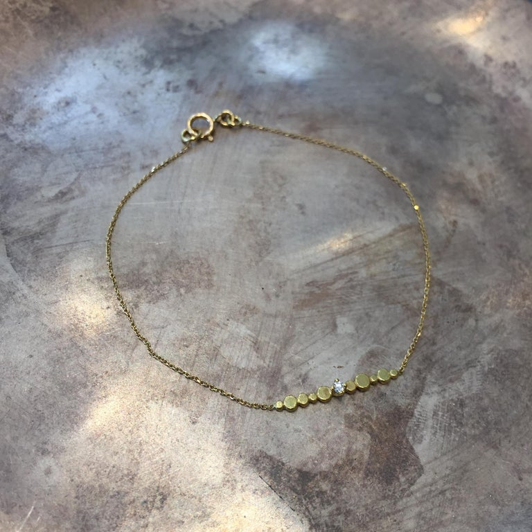 Sweet Pea fine chain bracelet made from 18k yellow gold forms part of our Bits and Bobs collection. The total length of this bracelet is 17cm but it can be ordered in any required size. Set into the length of sparkling gold diamond cut chain, the