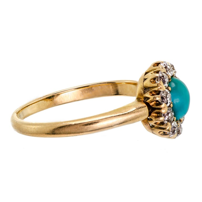 Sweet Victorian turquoise and diamond ring circa 1895 containing one (1) oval cabochon turquoise accented by ten (10) Old European Cut diamonds with an approximate total weight of 0.40cts all set in a yellow gold ring mount.  Ring tests as 14Kt but