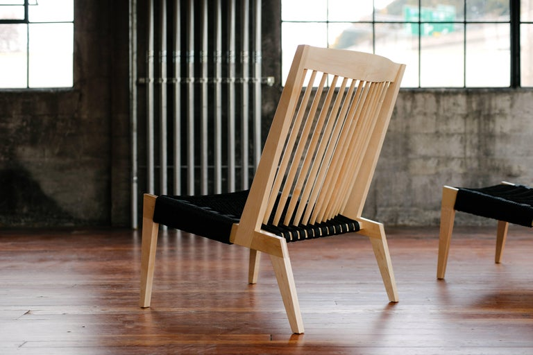 Phloem Studio Swift easy chair is a modern contemporary lounge chair with a solid wood frame and a rope woven seat handmade custom to order. With a high spindle back and hand crafted bridle joinery clearly displayed, the frame is very dynamic.