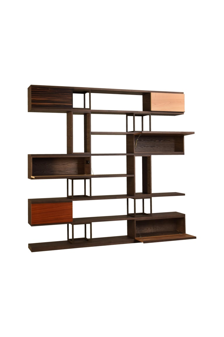 Contemporary style open bookcase, with shelves and modular elements made of ashwood The structure is supported by varnished metal empty cubes Available in different color combinations Designed by Libero Rutilo for Morelato.