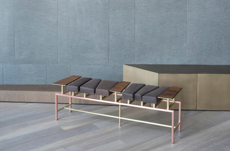 Swing is a bench seat of an irregular shape. Copper, brass, Santos rosewood and nubuck leather of an extremely soft hand define this seat with a look that is sculptural, elegant and light. The rosewood elements, positioned on brass sheets of a