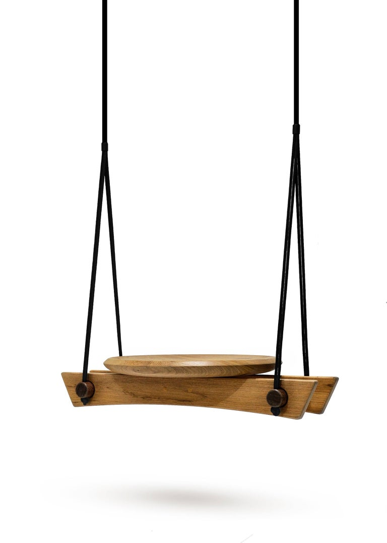 Swing Viga is handcrafted in solid wood Freijó.