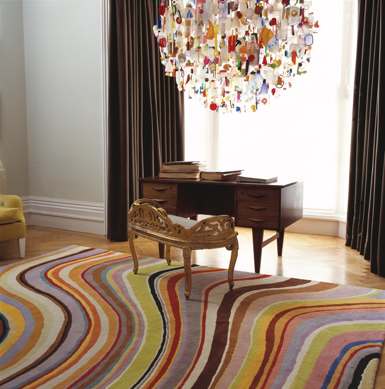 Paul Smith's signature Swirl is instantly recognizable as a work of graphic genius. In washed-out, muted tones of pale olive, ginger, grey and cream, this hand-knotted rug in pure Tibetan wool is an ultimate expression of this iconic