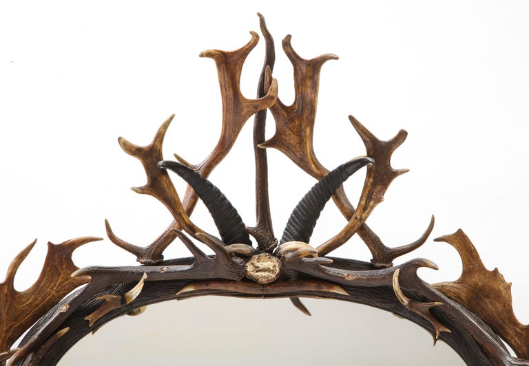 Swiss 'Black Forest' Antler and Boar Tusk-Mounted Mirror, Early 20th Century In Good Condition For Sale In New York, NY