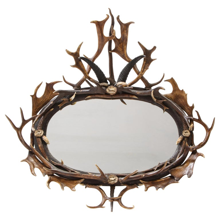 Swiss 'Black Forest' Antler and Boar Tusk-Mounted Mirror, Early 20th Century For Sale