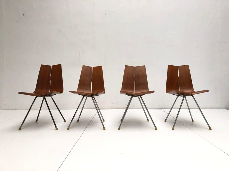 Rare set of 4 original early production GA dining chairs by Swiss designer Hans bellmann produced by Horgen Glarus late 1950's   Beautiful curved Teak plywood seating on a chromed metal base  Fixed just with 2 special engineered nuts & bolds the