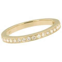 Swiss Made 18 Karat Yellow Gold and Diamond Band