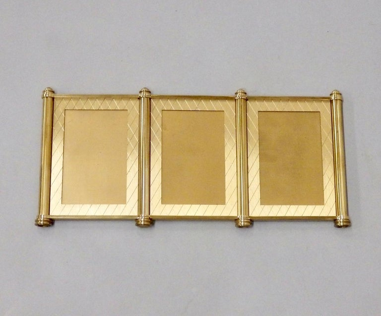 Jewel like quality machined brass picture frames. Original box shows minor wear . Marked Made in Switzerland . Cross hatch design on brass face very much in the style of Tommi Parzinger .