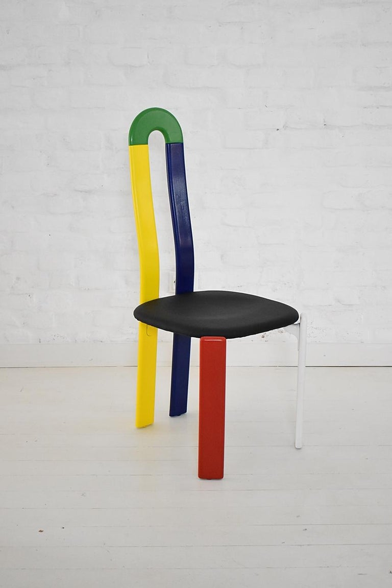 Vintage industrial 1970s iconic chair designed by Bruno Rey for Dietiker Switzerland The Rey chair is famed internationally and is the first patented chair with Dietiker's unique screwless wood-to-metal connection Wood frame in multi-color lacquer