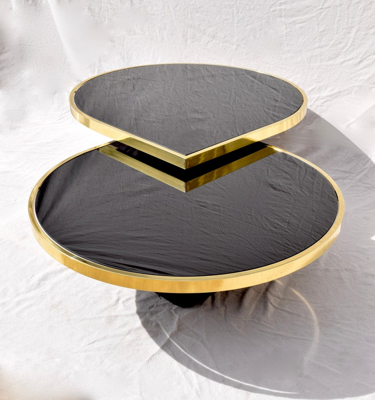 Swivel Brass & Black Glass Cocktail Table by Design Institute of America For Sale 9