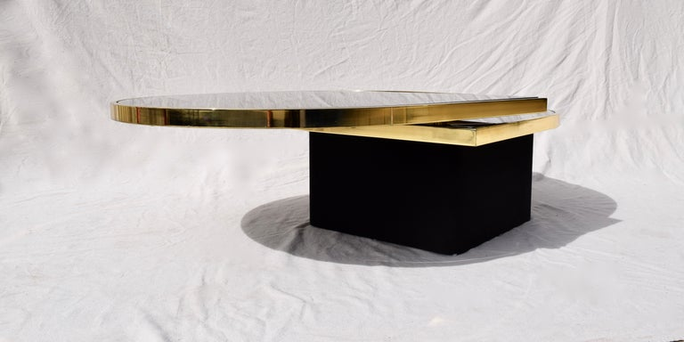 American Swivel Brass & Black Glass Cocktail Table by Design Institute of America For Sale