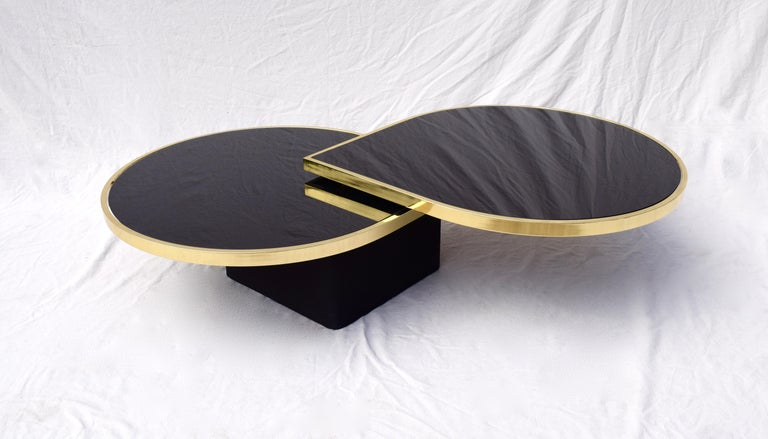 Late 20th Century Swivel Brass & Black Glass Cocktail Table by Design Institute of America For Sale