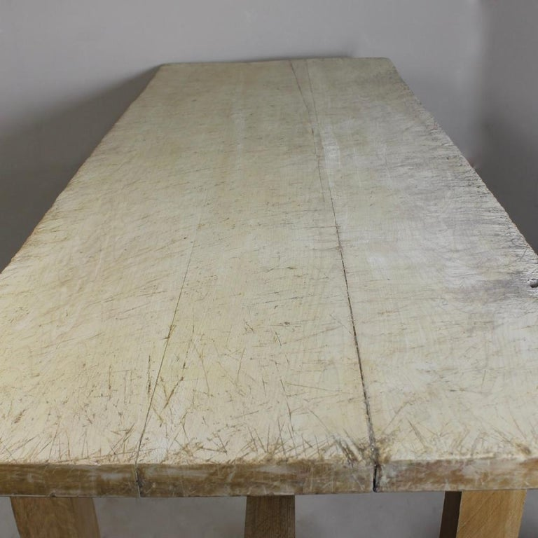 A large early to mid-20th century, oak and sycamore, kitchen preparation table. The top a beautifully weathered, pale and worn scrubbed sycamore, the base, peg constructed solid oak.  This came from a historic traditional independent pork pie