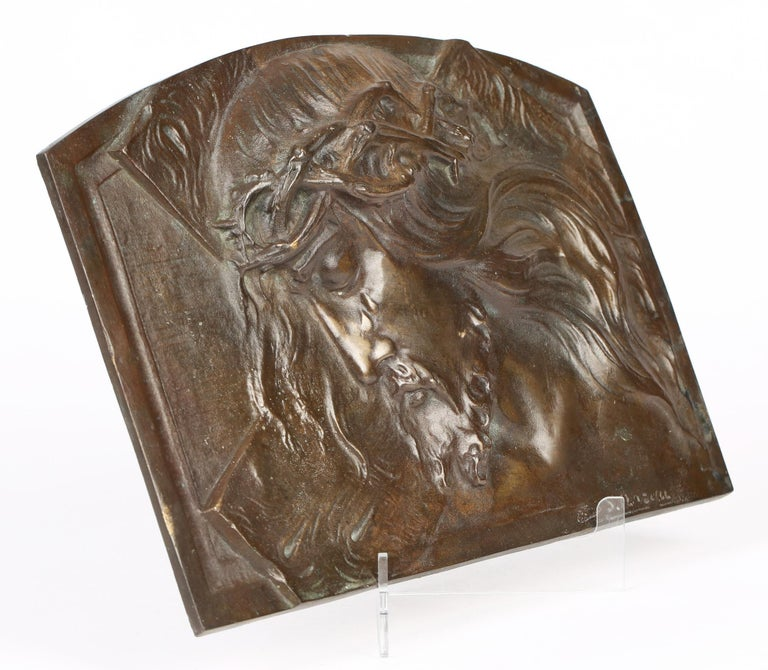 A stunning 'Art Deco' bronze plaque depicting Christ wearing the crown of thorns by renowned Belgian artist and sculptor Sylvain Norga (1892-1968) and dating from around 1920-30. The relief deep molded plaque is of rectangular shape with a slightly