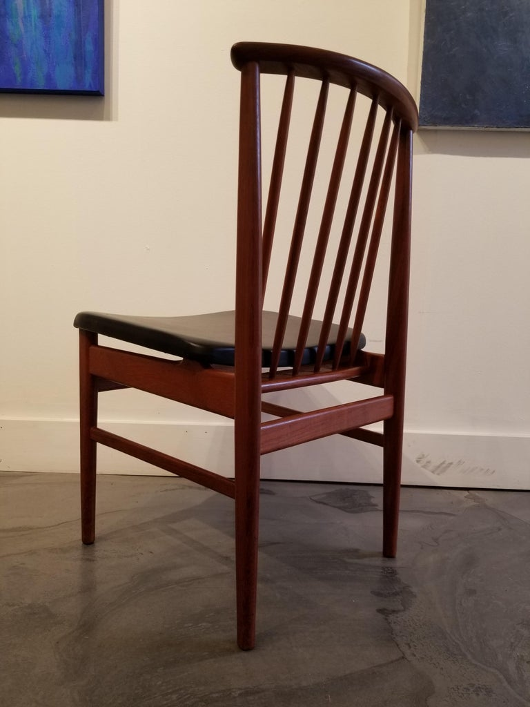 Uncommon and scarce set of 6 Scandinavian Modern high-back dining chairs designed by Sylve Stenquist for DUX, Sweden, circa 1960. Substantially crafted in solid teak. Spindle back design with architectural chair frames. Original finish and original