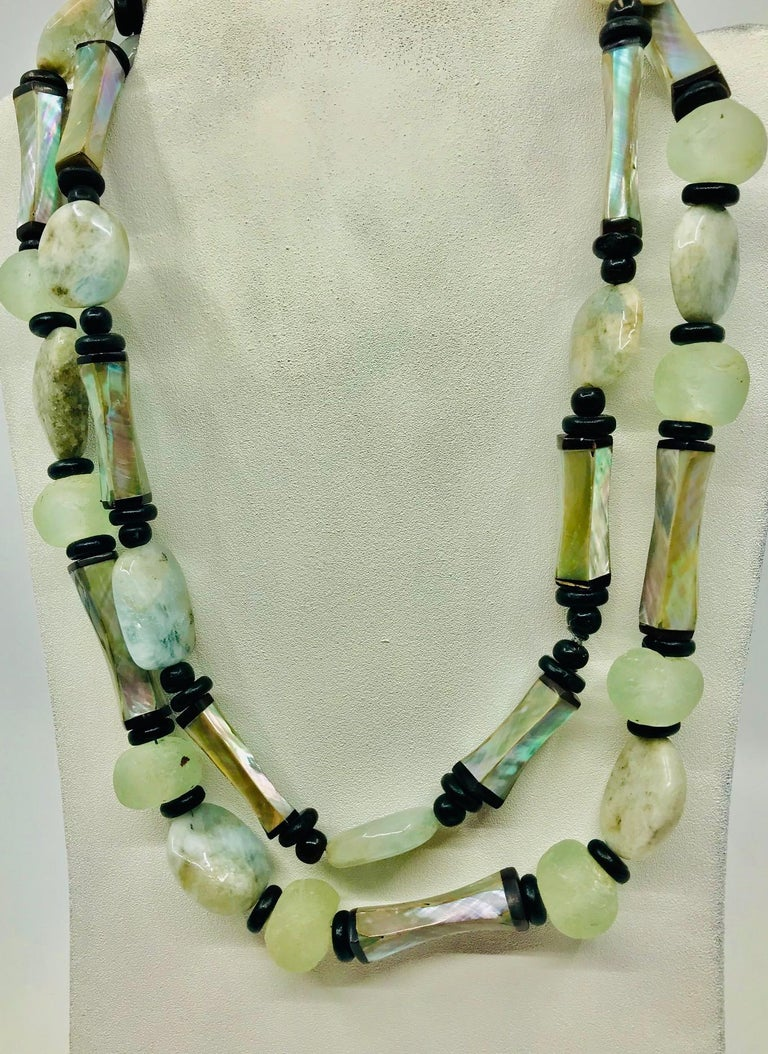 Long Haliotis /Abalone and Glass beads Statement Necklace. The exceptional high quality Abalone beads with black Horn ends were produced during French Deco period.In this necklace they are combined with African glass beads and small round wooden