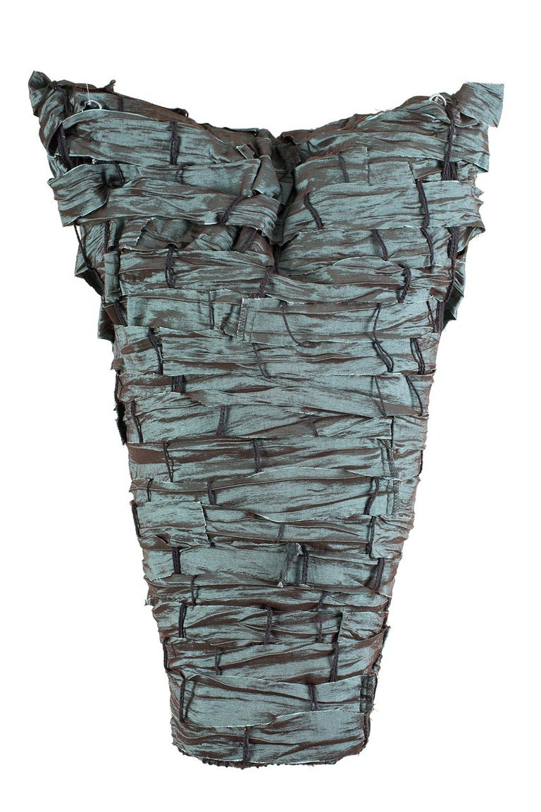 """""""Strong and Beautiful"""" by Sylvia Vander Sluis is a 19 x 14 x 6 inch fiber sculpture of handwoven, dusky-turquoise fabric with an iridescent sheen. Part of the """"Torso"""" series, this piece is formed over a wire-mesh armature; hangs with monofilament"""