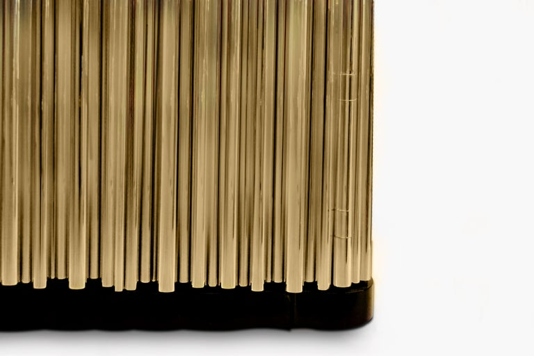 The symphony sideboard draws inspiration from church organ tubes, as well as the curves of a violin. Like all of Boca do Lobo's designs, the Symphony is handmade by experienced craftsmen, each with different specialties, from metal-work to wood