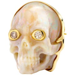 Syna Ethiopian Opal Yellow Gold Skull Brooch and Pendant with Champagne Diamonds