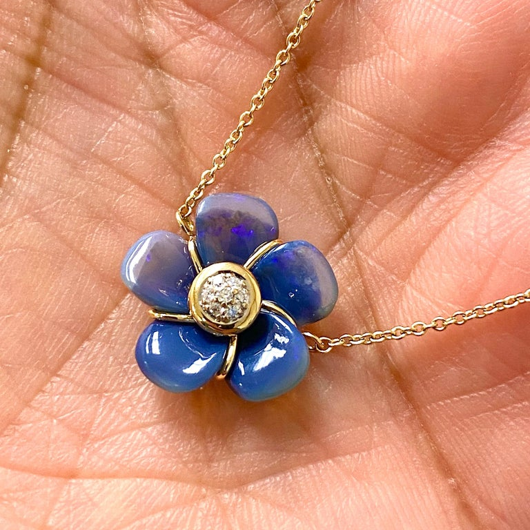 Created in 18kyg Handcarved Australian opal flower 4 cts approx Diamonds 18 inch cable chain with loops at 16th & 17th inch Lobster clasp One of a kind    About the Designers  Drawing inspiration from little things, Dharmesh & Namrata Kothari have
