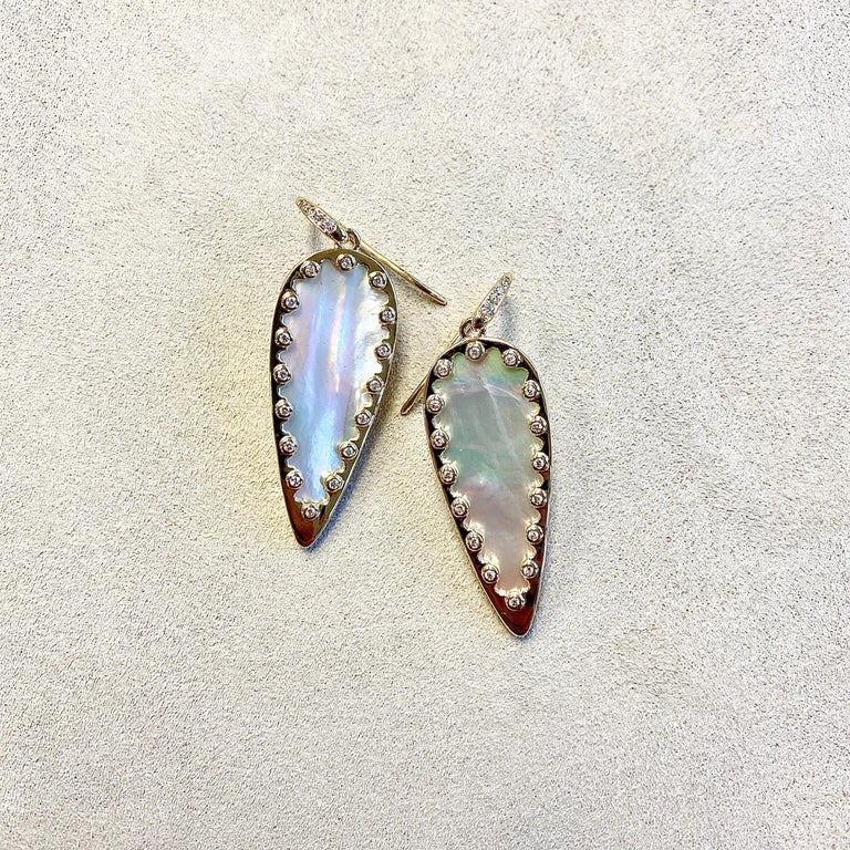 Created in 18 karat yellow gold Mother of pearl 10 cts approx Champagne Diamonds 0.20 ct approx Limited edition   About the Designers ~ Dharmesh & Namrata  Drawing inspiration from little things, Dharmesh & Namrata Kothari have created an